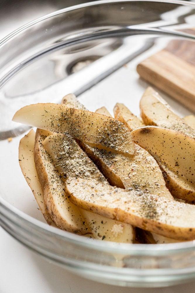 seasoned potato wedges in a bowl