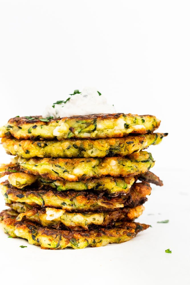 a stack of zucchini and feta fritters