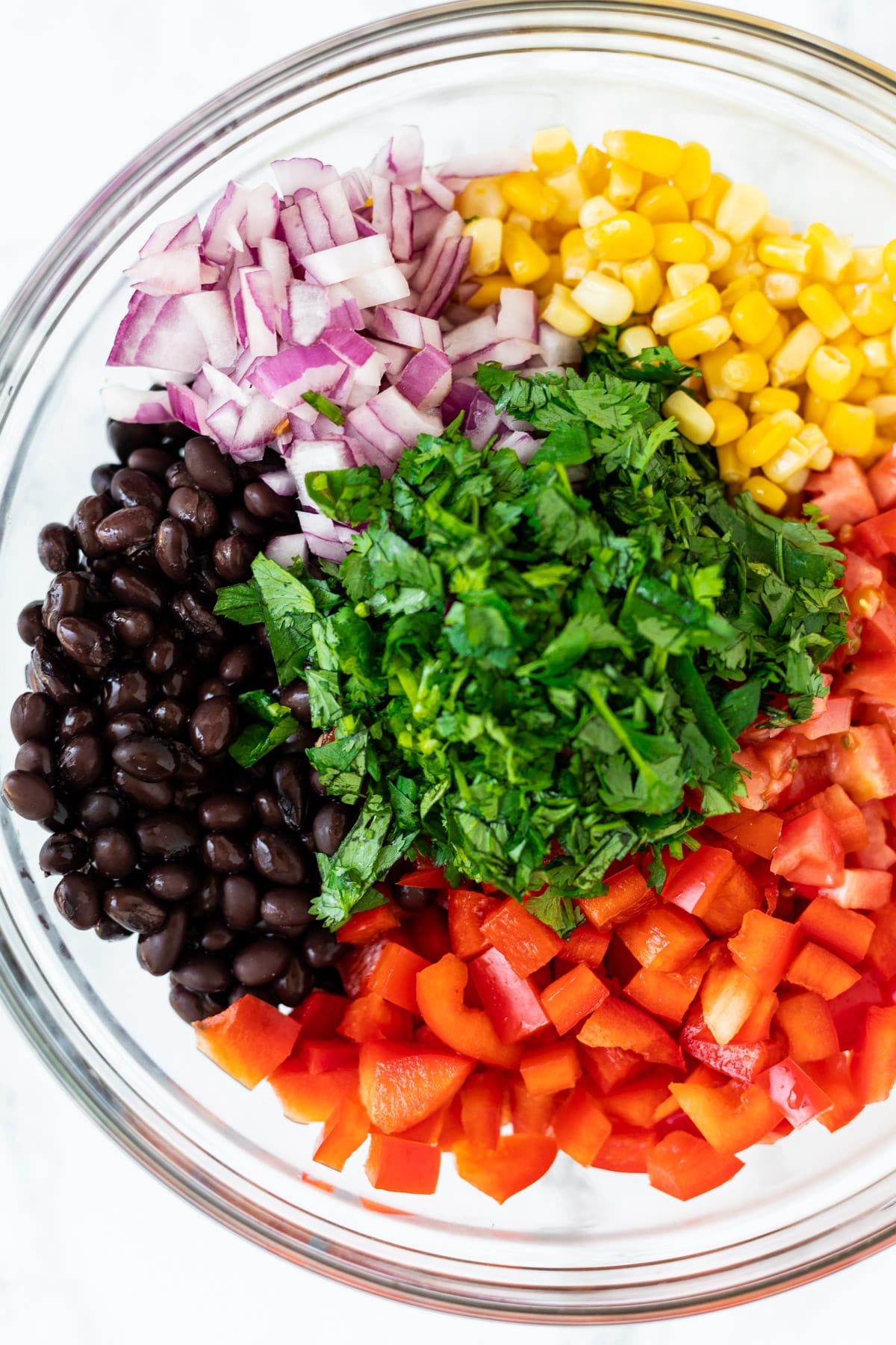 ingredients for black bean and corn salad in a bowl,