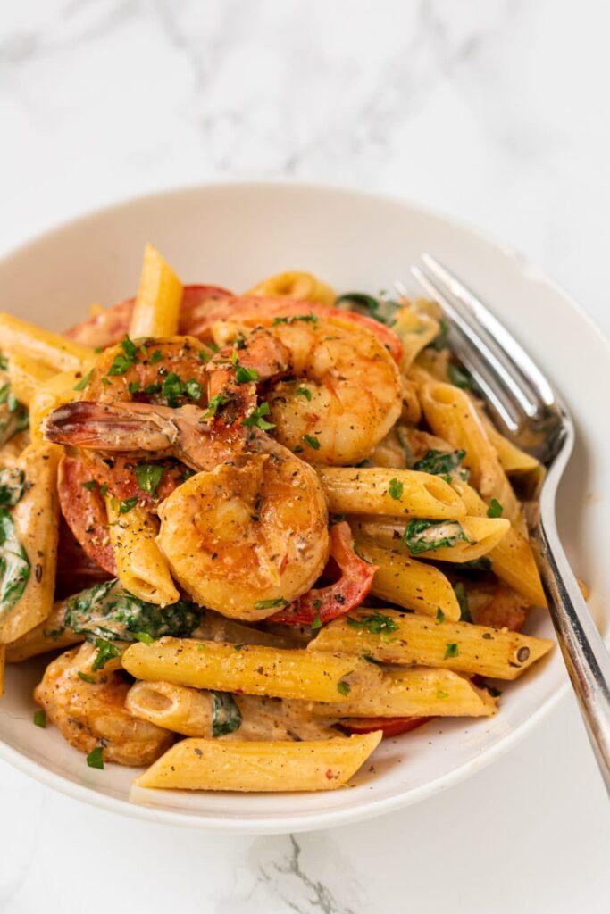 a side view of a bowl of cajun shrimp pasta