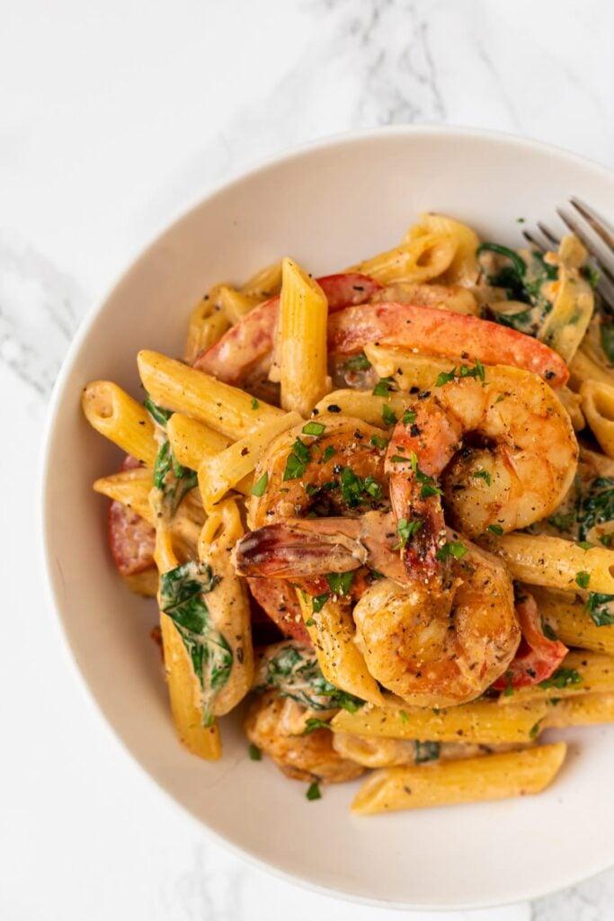 a top down view of a bowl of cajun shrimp pasta