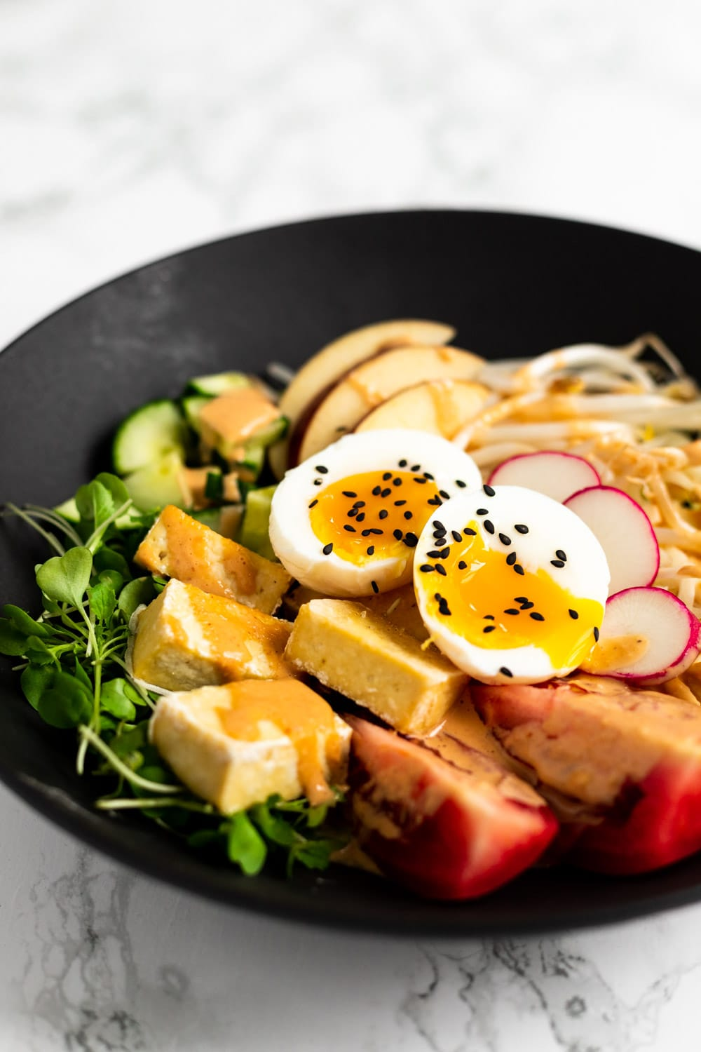 A side view of a bowl of gado gado.