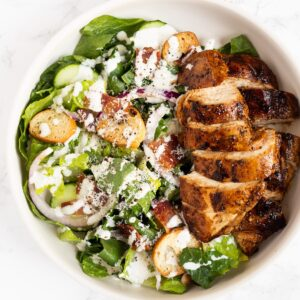 a top down view of balsamic chicken caesar salad