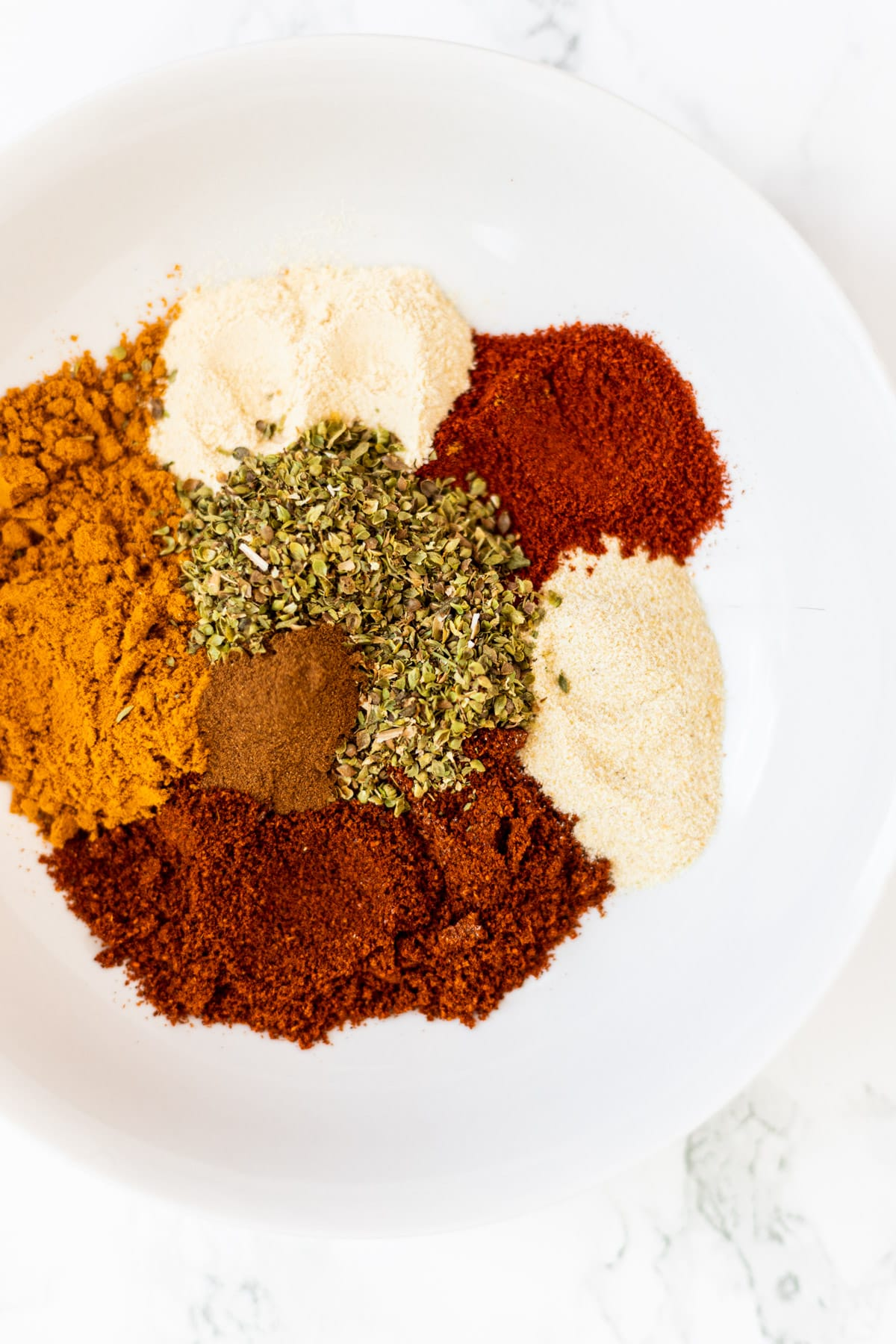 A top down view of a bowl of taco spices.