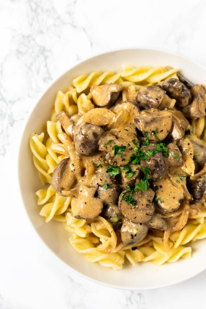 Creamy vegetarian mushroom stroganoff.  Quick to make and easy to prepare this comforting vegetarian dish can be ready to eat in about 30 minutes and served with anything from pasta to potatoes.