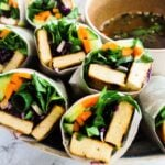 A close up view of banh mi summer rolls on a plate.