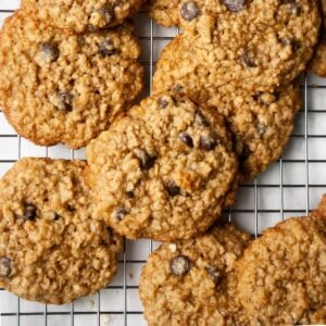 Chewy oatmeal chocolate chip cookies on a cooling rack.