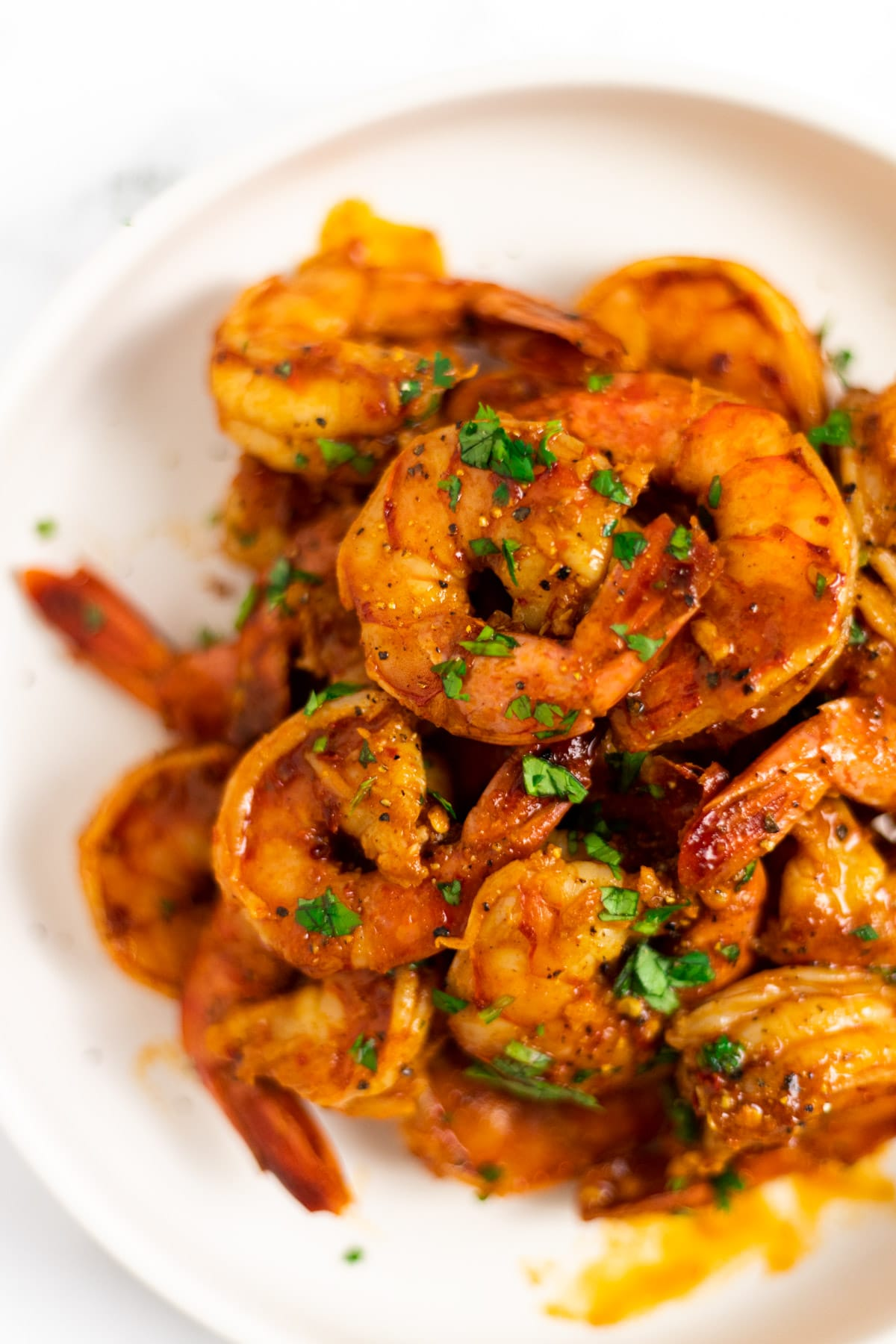 A side view of a bowl of chili lime shrimp.
