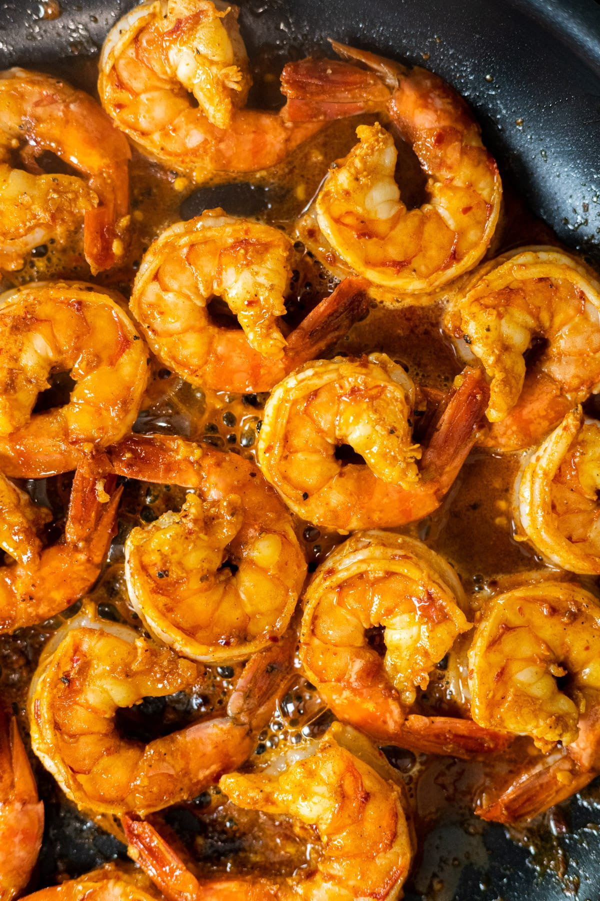 Cooked chili lime shrimp in a skillet.