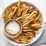 a top down view of a bowl of crispy oven fries.