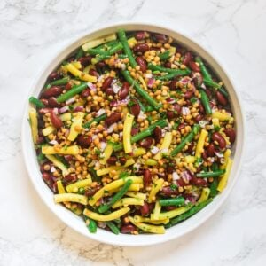 A top down view of a bowl of bean salad with lentils.