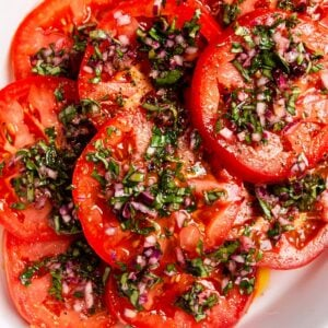 A close up view of a plate of Italian tomato salad.
