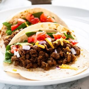A close up view of lentil tacos on a plate.