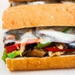 A close up view of a vegetarian mushroom philly cheesesteak sandwich.