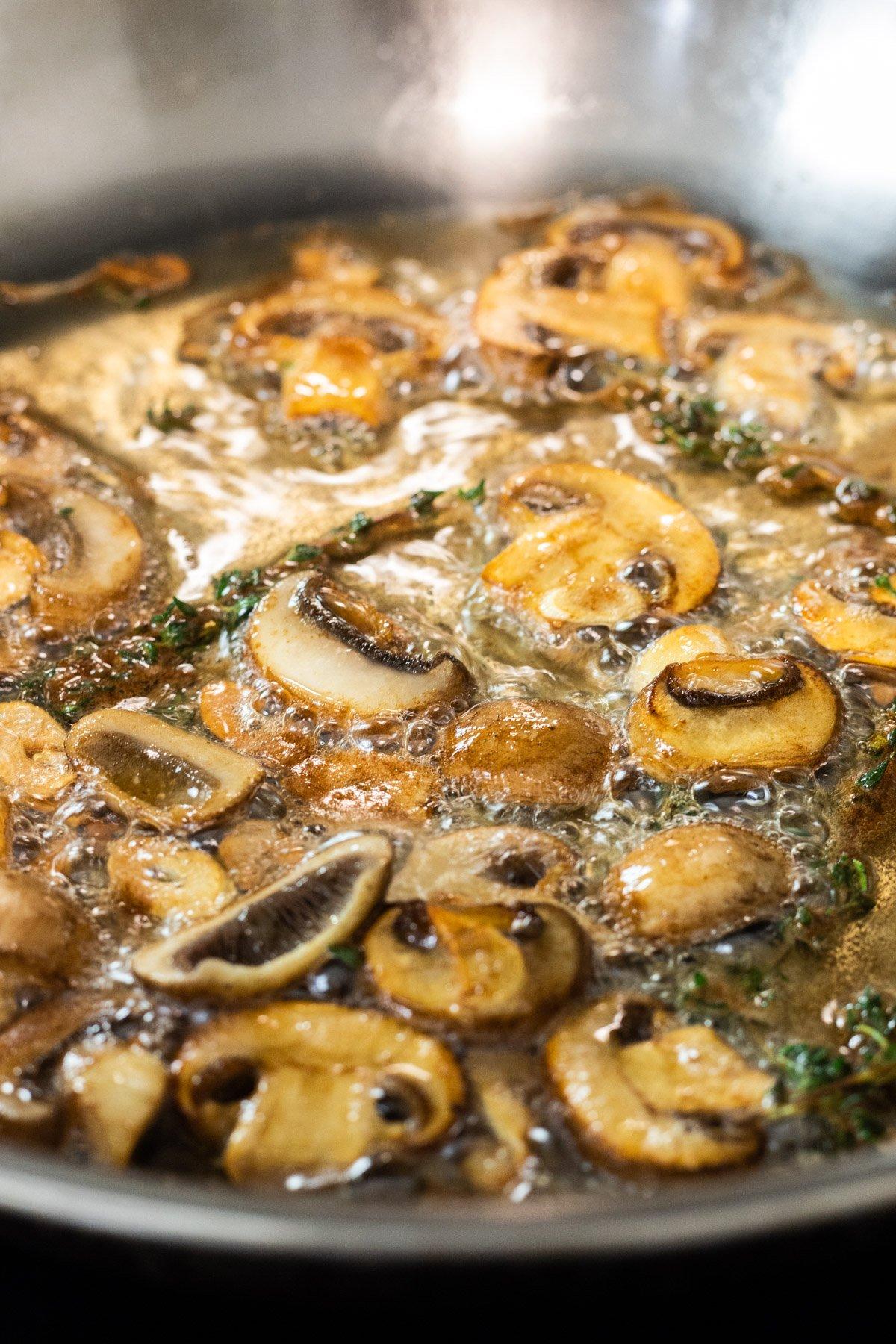 browned mushrooms in a skillet
