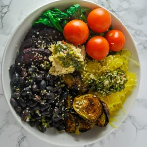 a top down view of a roasted winter vegetable bowl.
