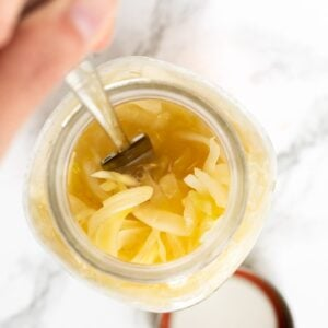 a top down view of sauerkraut in a mason jar.