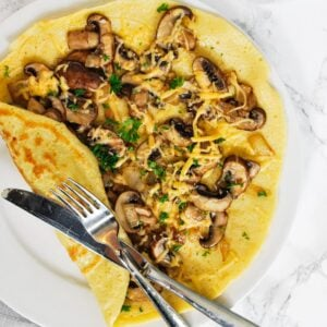 A close up view of Dutch pancake with mushrooms and cheese.