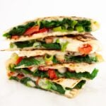 A side view of a stack of spinach quesadillas.