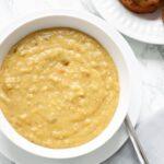 A close up view of a bowl of vegan split pea soup.