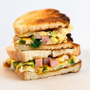 a side view of two halves of a western sandwich stacked on each other.