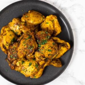 a top down view of a plate of north African spiced chicken thighs