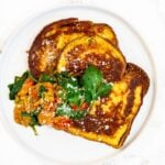 a top down view of savory French toast on a plate.