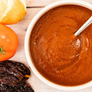 a top down view of a bowl of enchilada sauce.