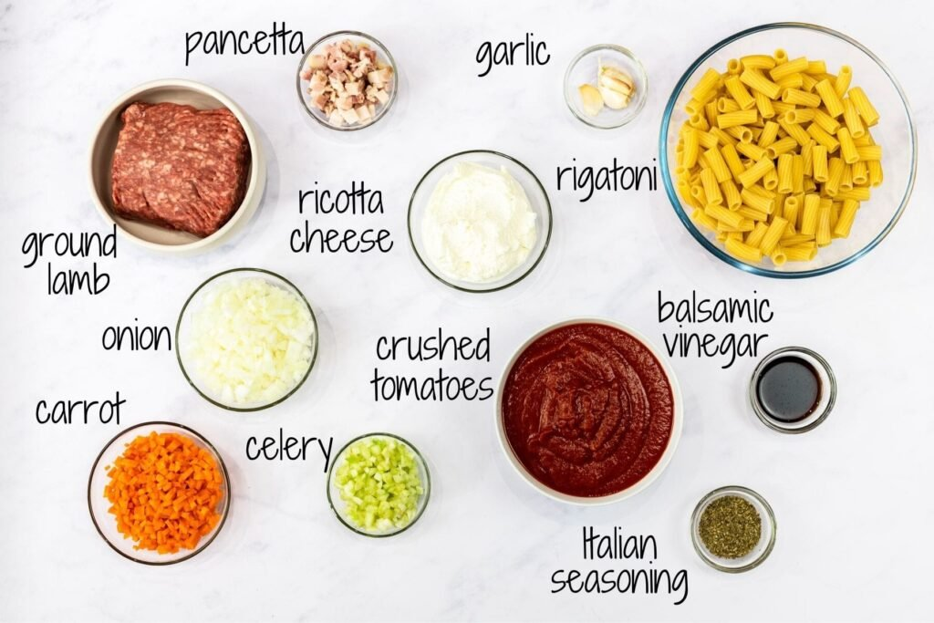 ingredients for lamb ragu with text labels.