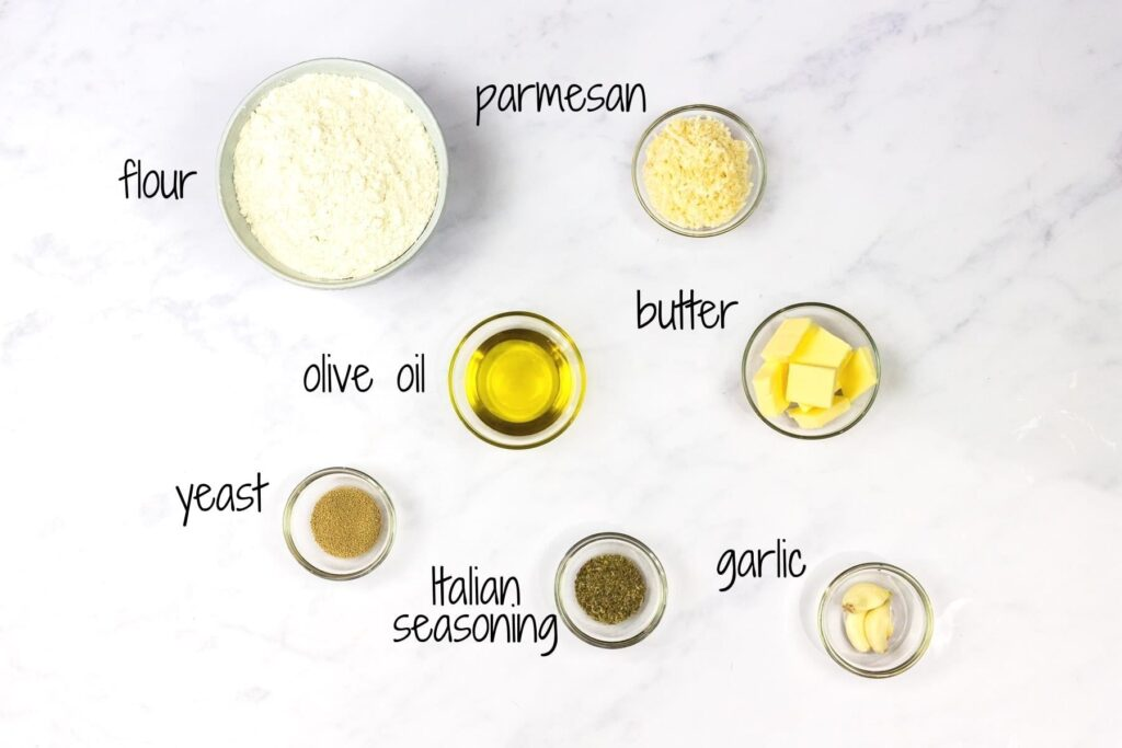 Ingredients for parmesan breadsticks with text laabels.