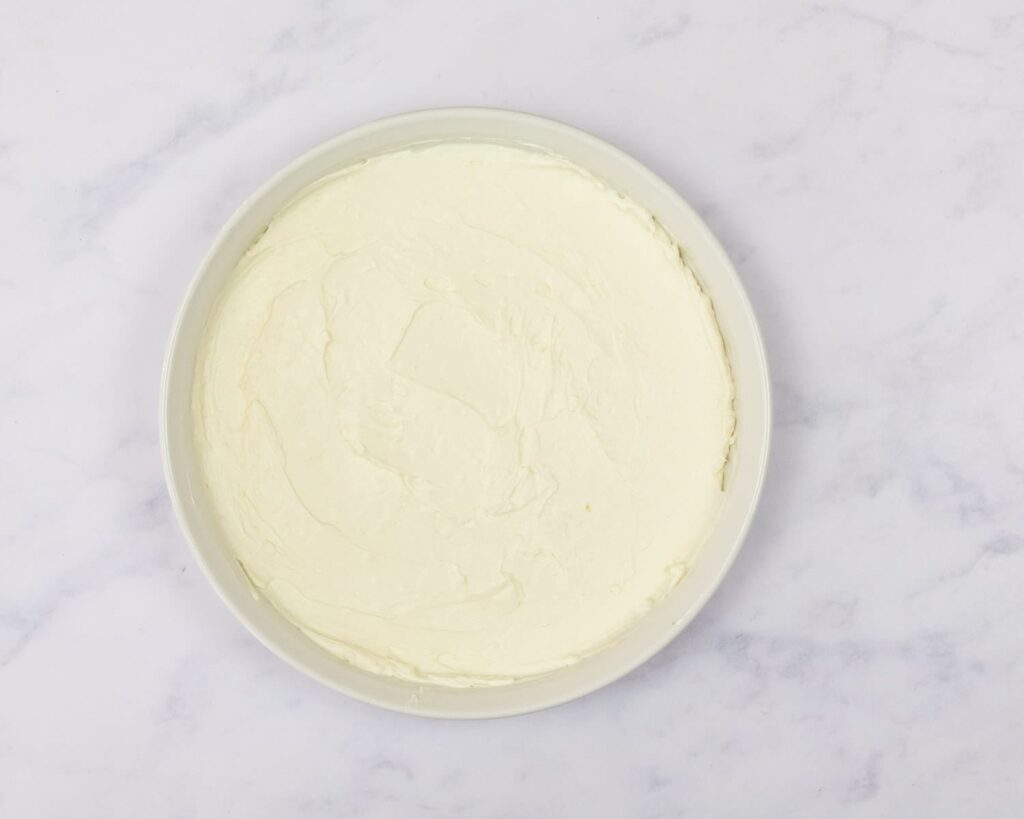 cream cheese base for pizza dip in a pie plate.