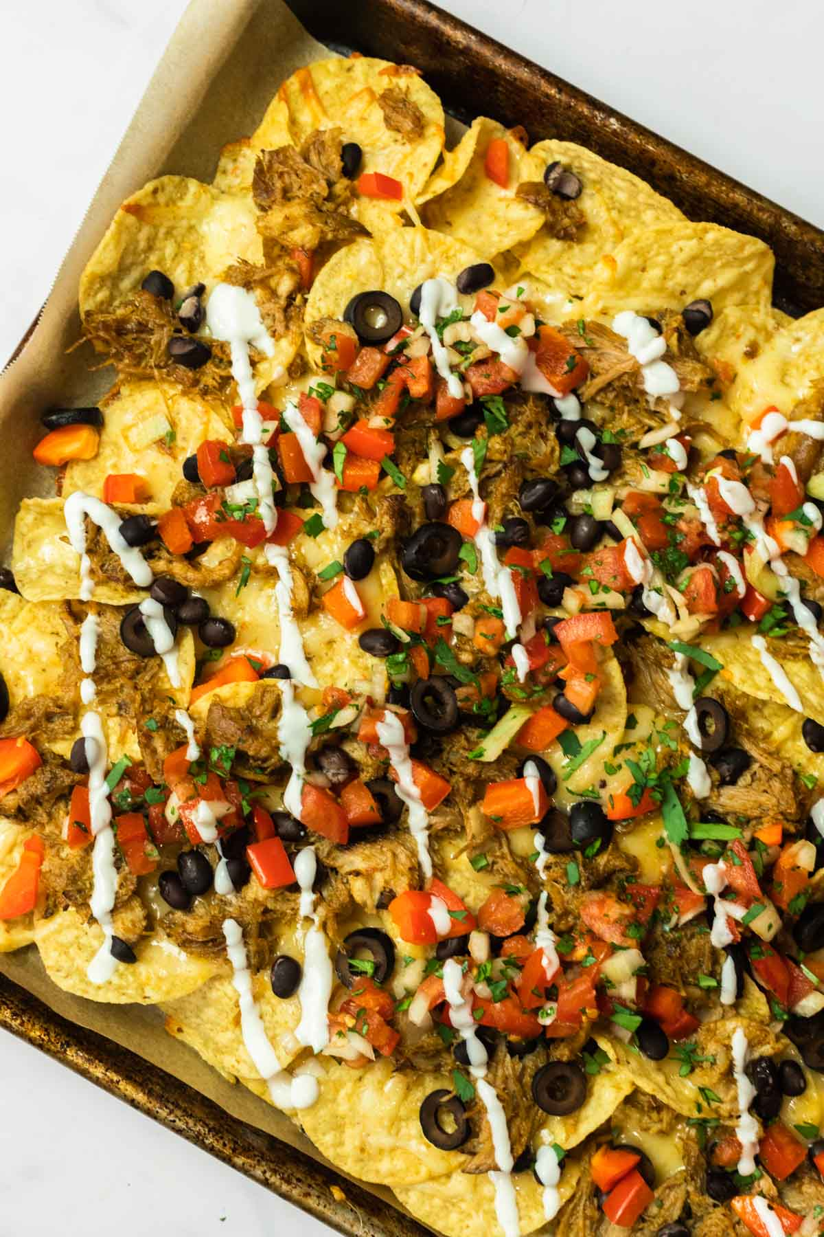 an overhead view of a tray of pulled pork nachos