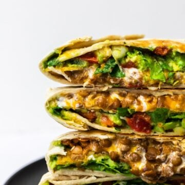 a side view of halved and stacked vegetarian crunchwrap supremes