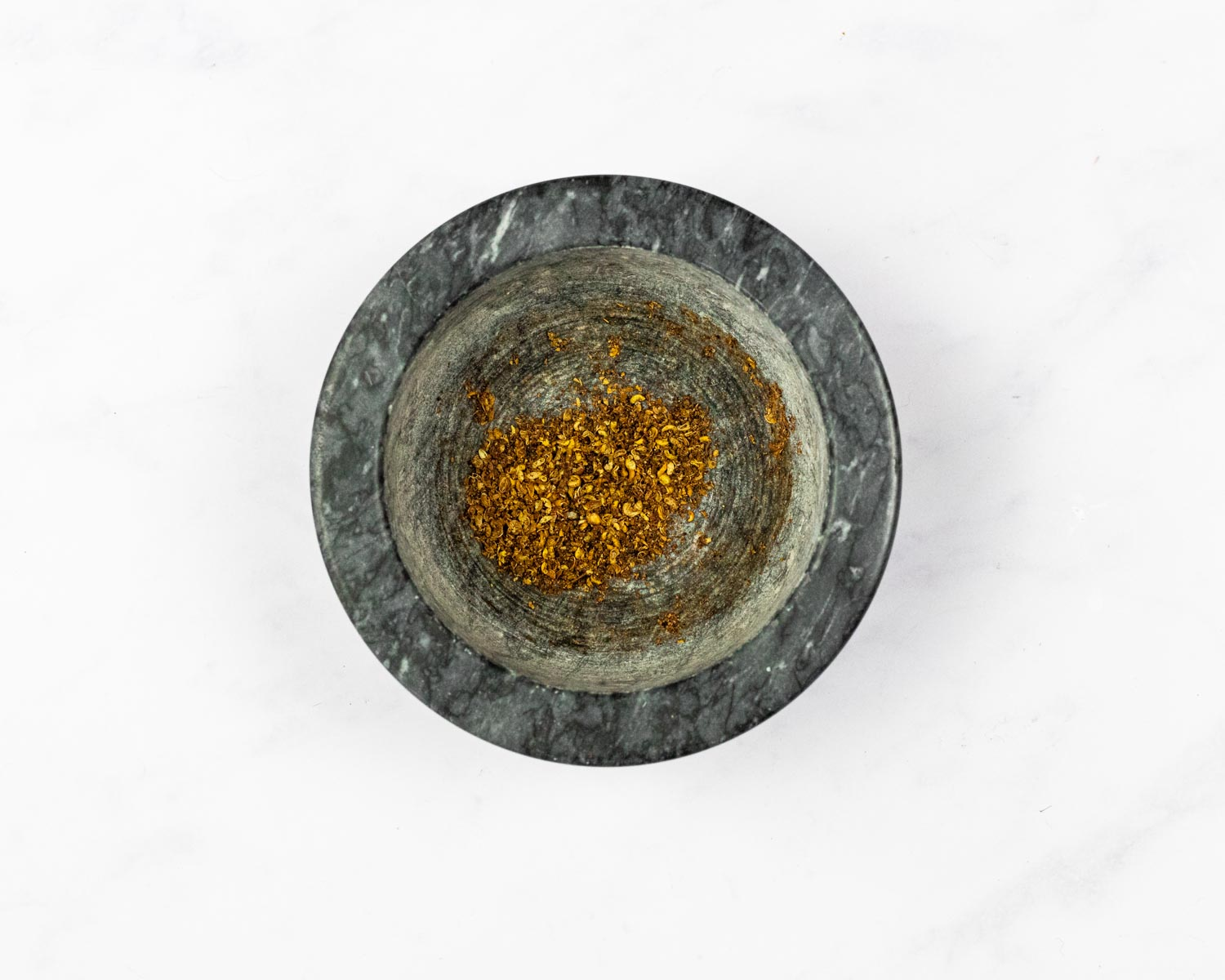 Toasted and ground Szechuan peppercorns in a bowl.
