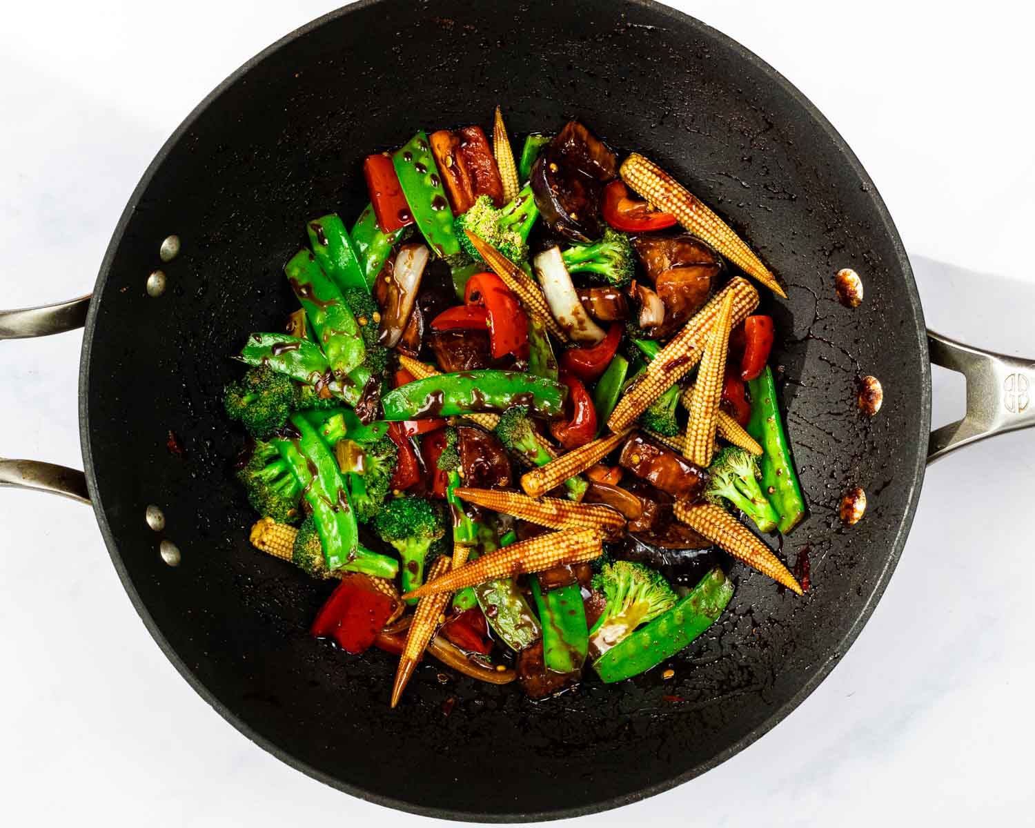 Kung Pao vegetables in a wok.