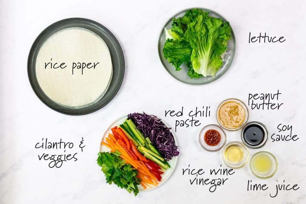 ingredients for veggie rolls and peanut dipping sauce with text labels.