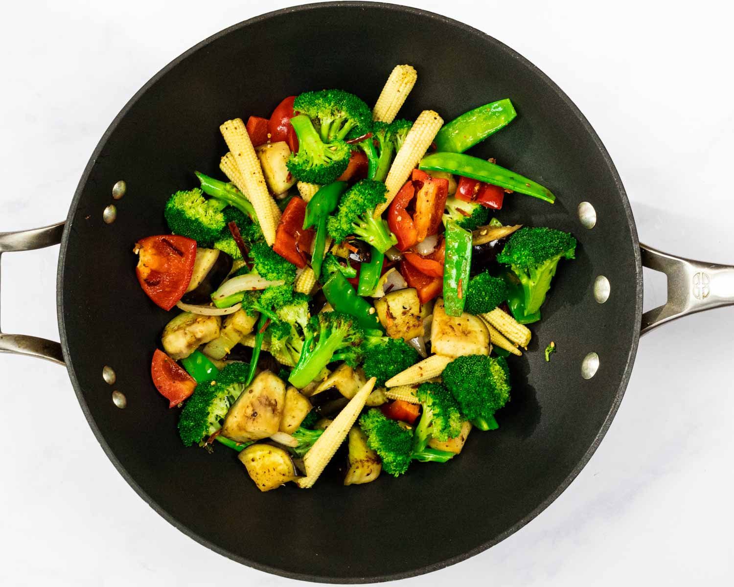 Stir-fried vegetables in a wok.