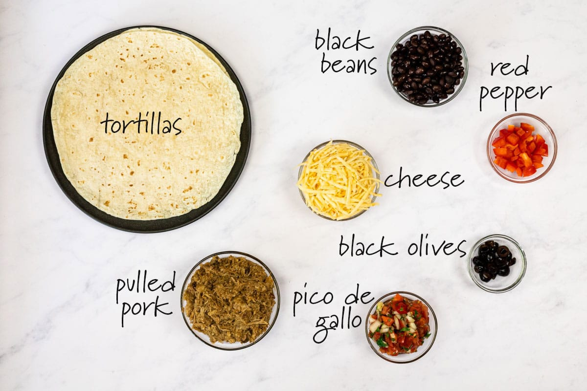ingredients for pulled pork quesadillas with text labels