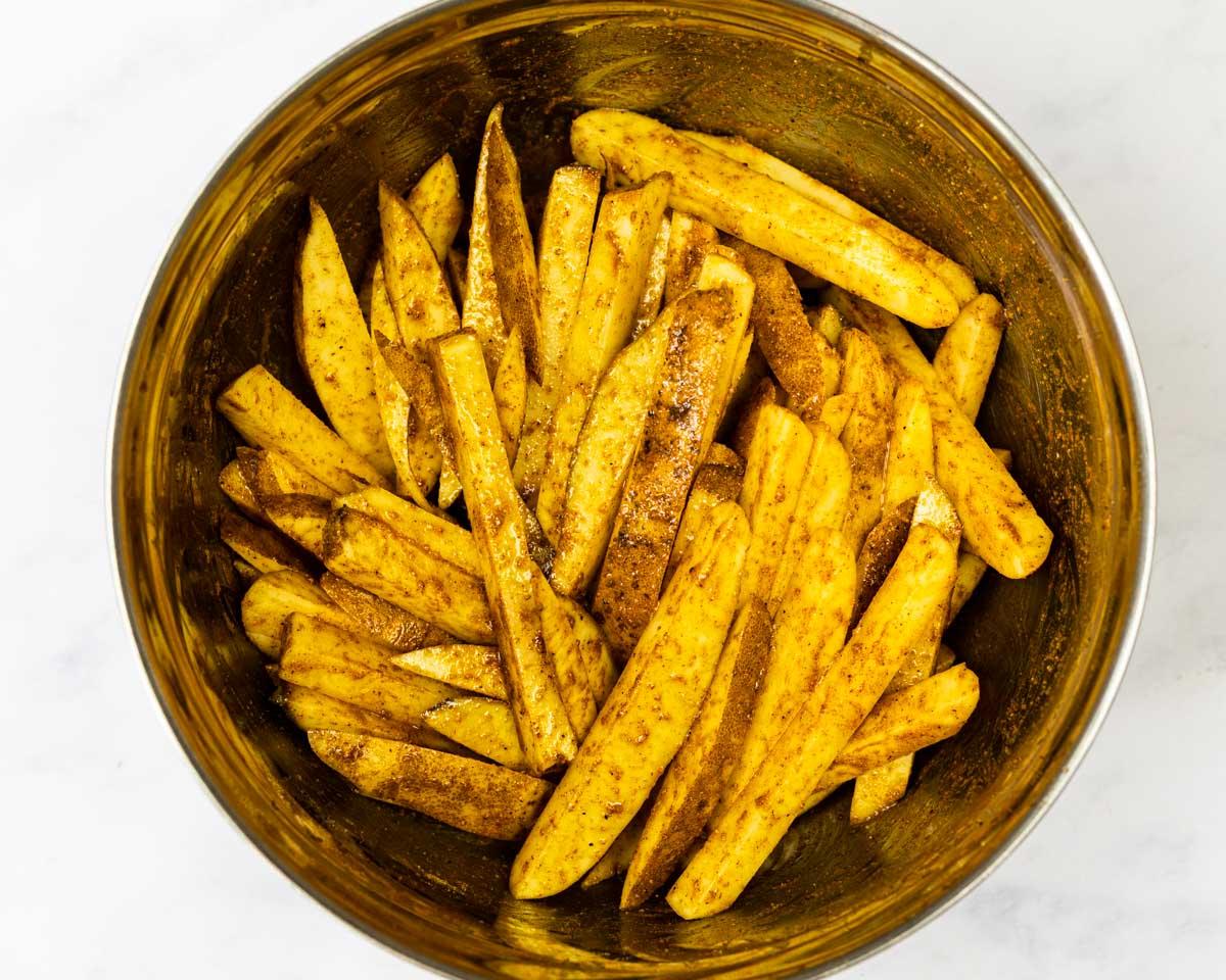 Seasoned fries in a bowl.