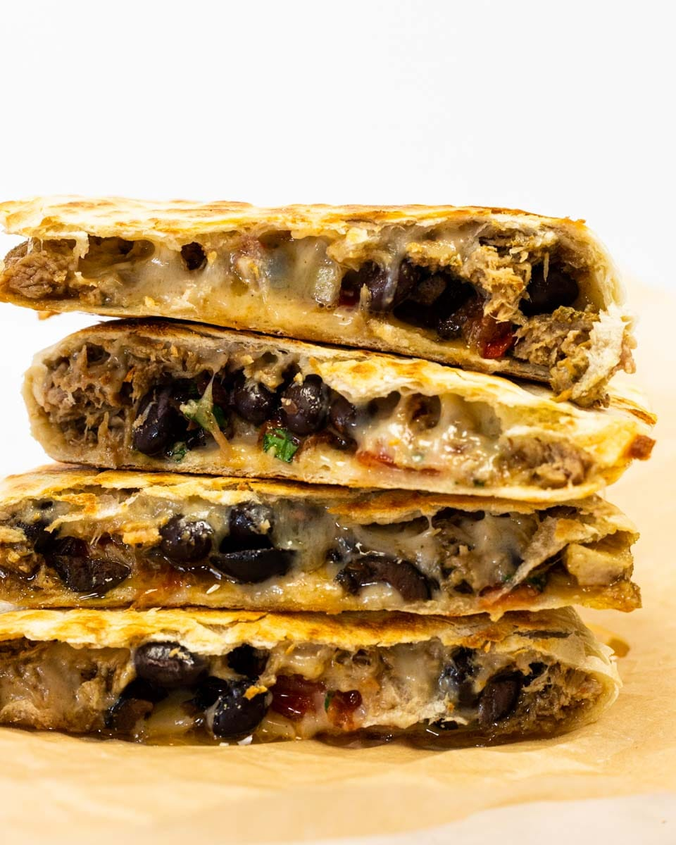 a side view of stacked pulled pork quesadillas