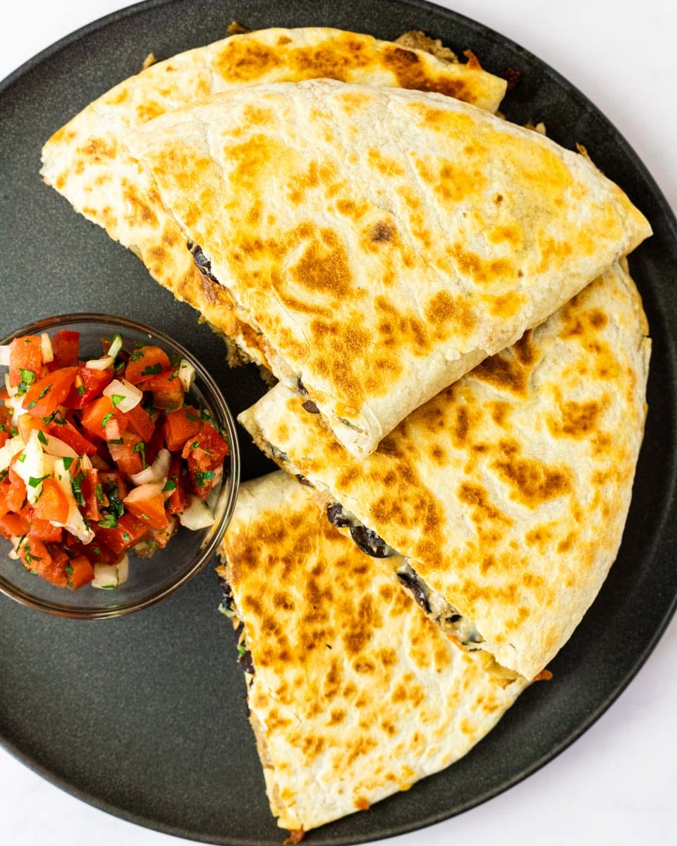 a top down view of a plate of pulled pork quesadillas.
