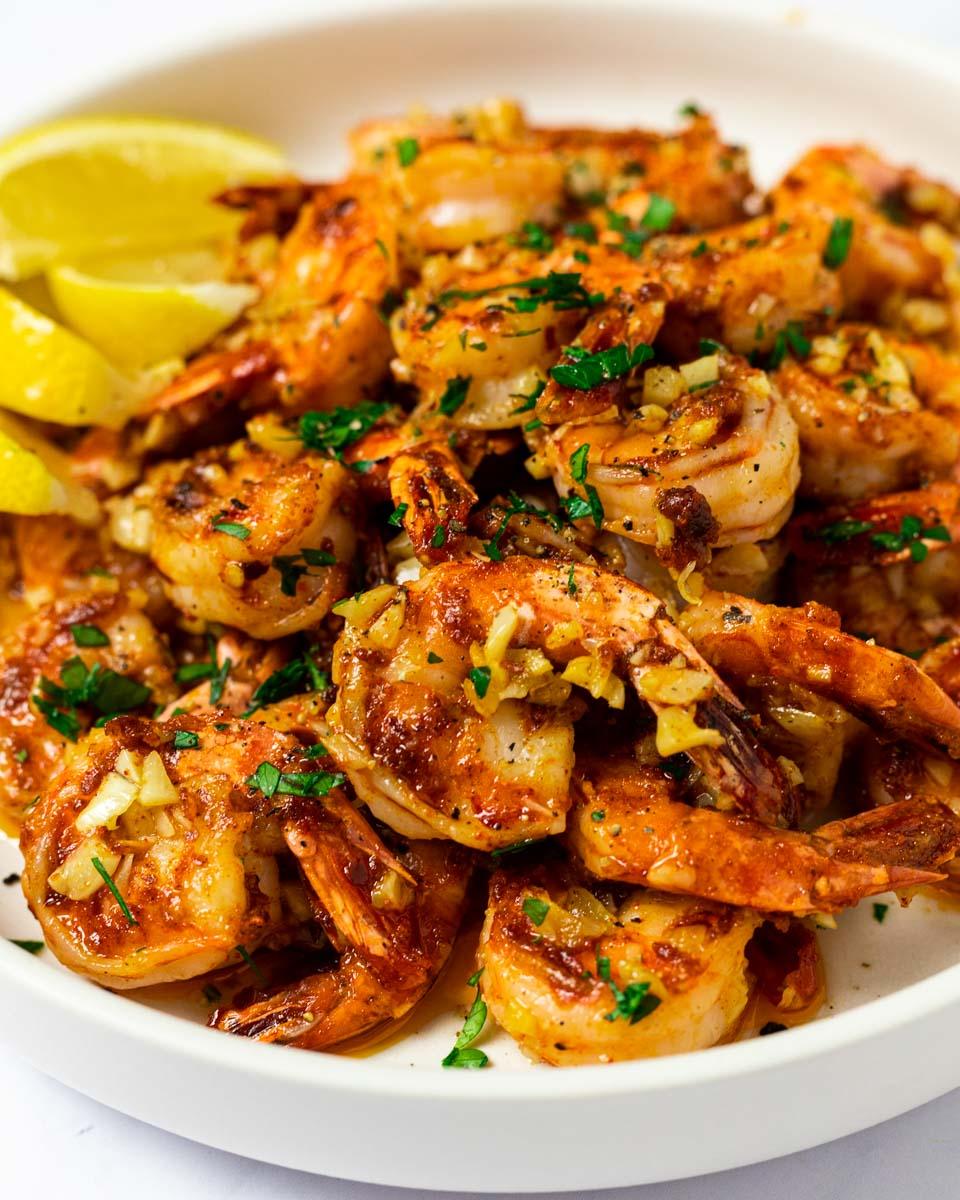 a side view of a plate of Hawaiian garlic shrimp
