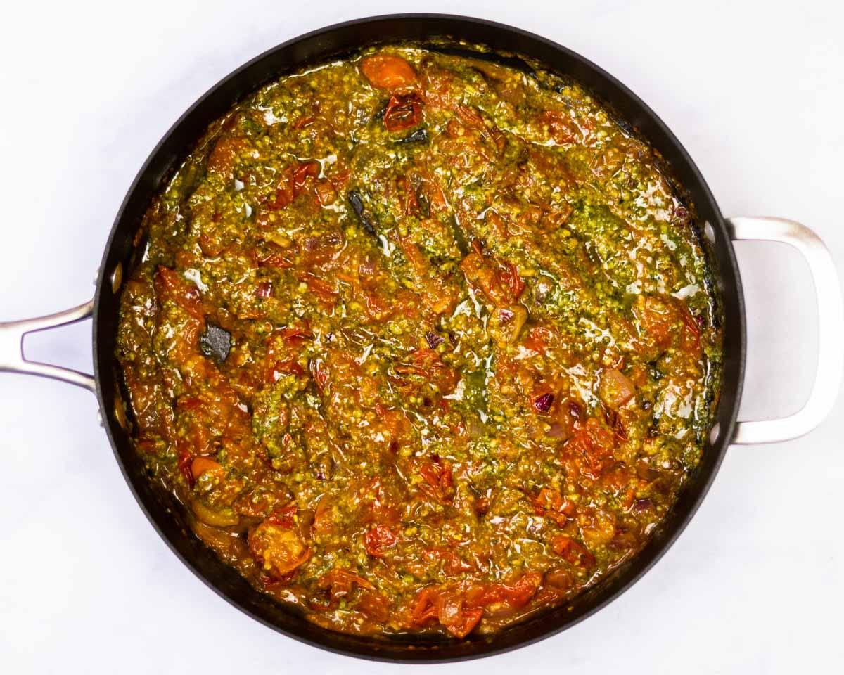 cherry tomato and pesto sauce in a saute pan.