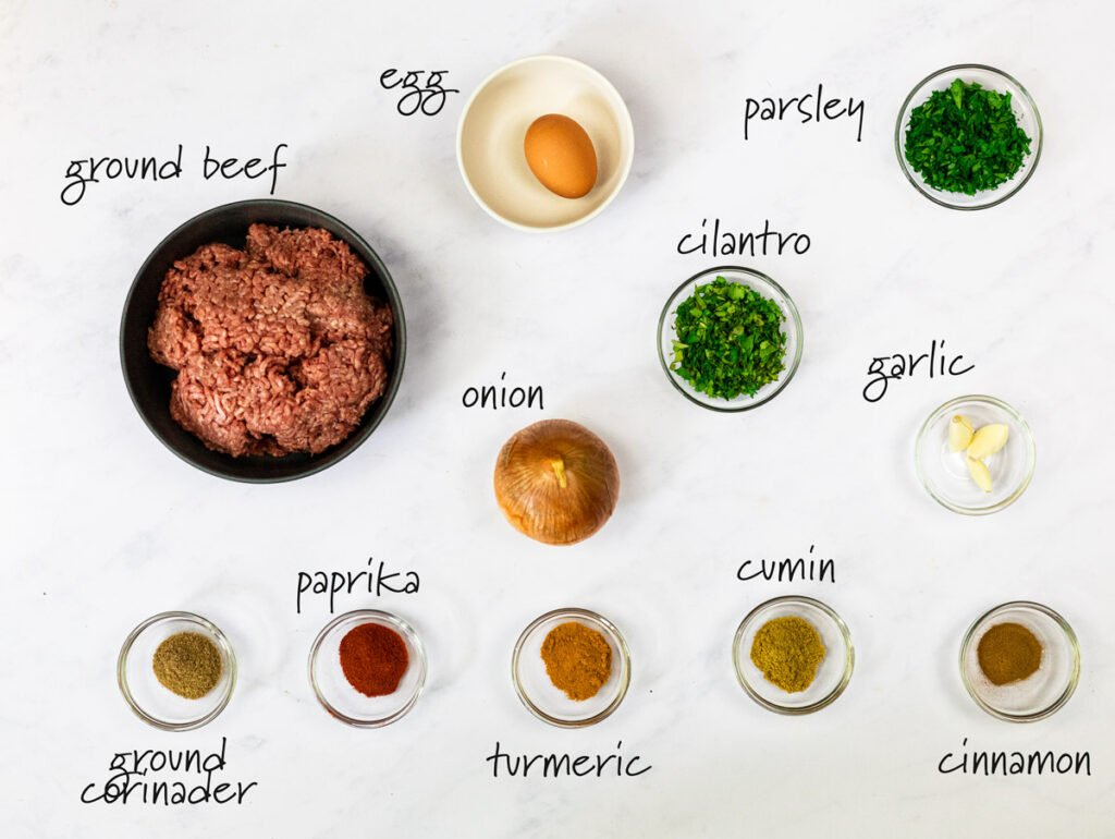 ingredients for beef kofta kebabs with text labels
