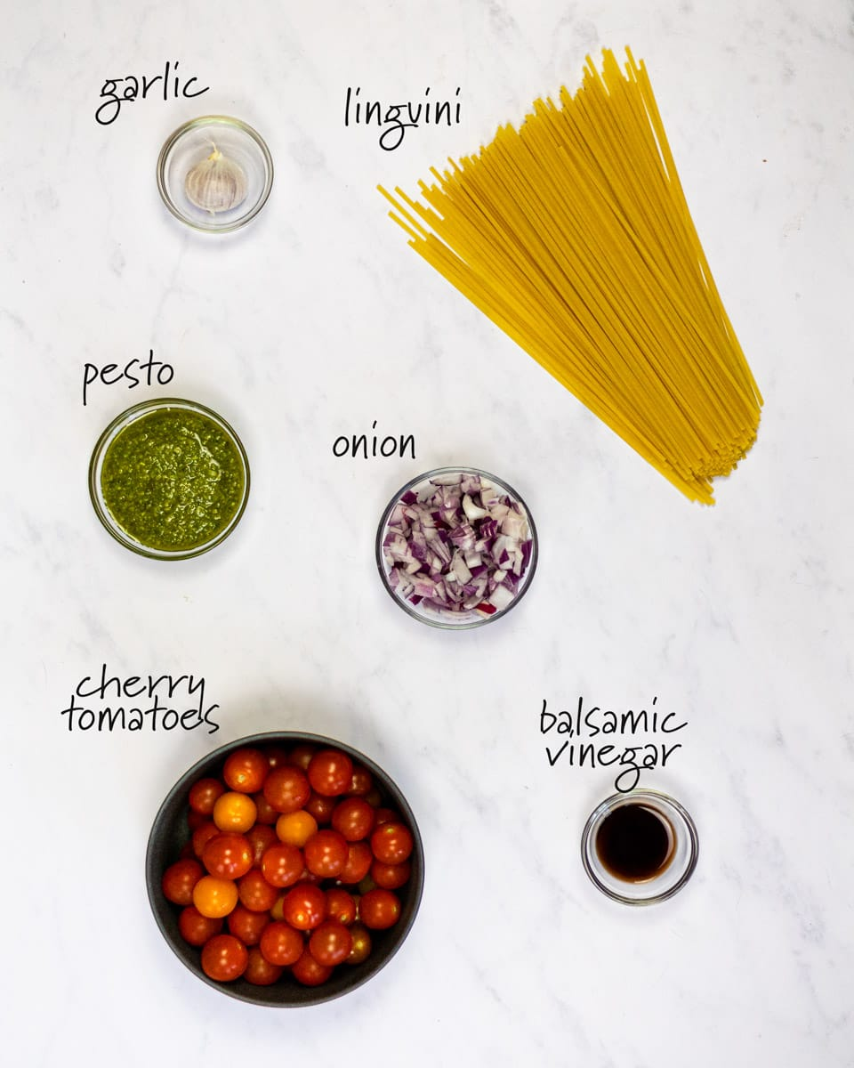 ingredients for cherry tomato pesto pasta with text labels.